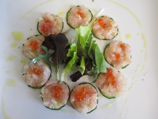 Red-snapper-tartare-on-a-sliced-cucumber-served-with-salmon-eggs-with-a-fresh-salad-on-olive-oli-dressing_-Resized